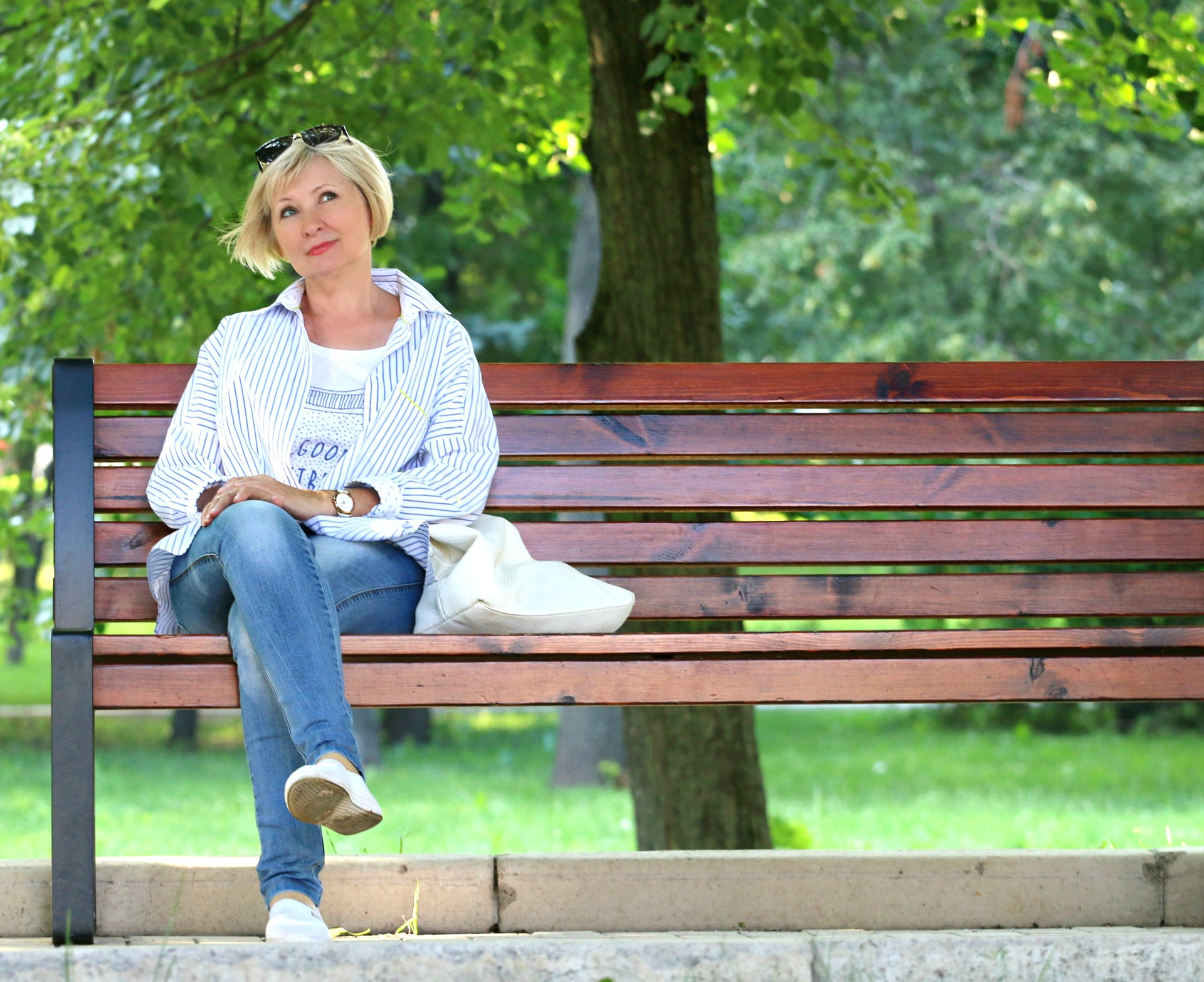 Middle-Aged Woman on Park Bench
